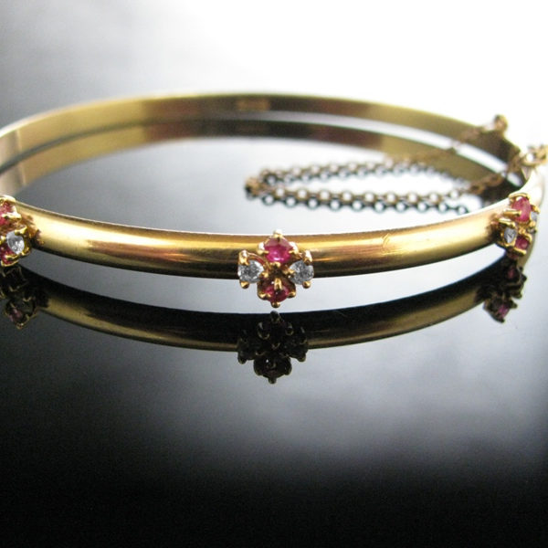 Rolled Gold Bangle With Red And White Gemstones
