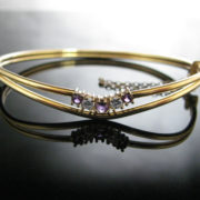 Rolled Gold Bangle With Purple And White Gemstones