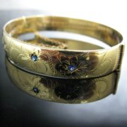 Rolled Gold Bangle With Blue Gemstones