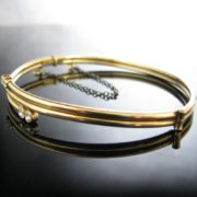 Rolled Gold Bangle with White Gemstones