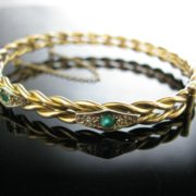 Rolled Gold Bangle With Green And White Gemstones